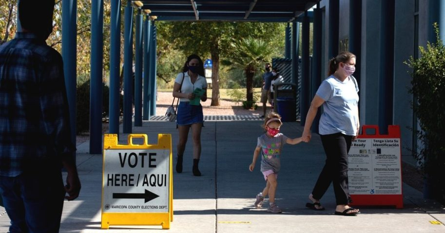 Voters enter the Southeast Regional Library in Gilbert, Arizona, to cast their ballots in the Nov. 3 general election.