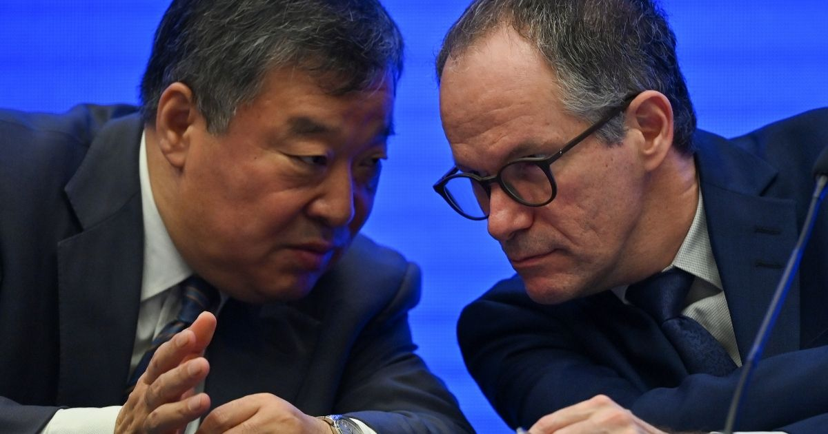 China's Liang Wannian, left, talks with Peter Ben Embarek of the World Health Organization during a news conference Tuesday following a visit by WHO experts to the city of Wuhan in China's Hubei province.