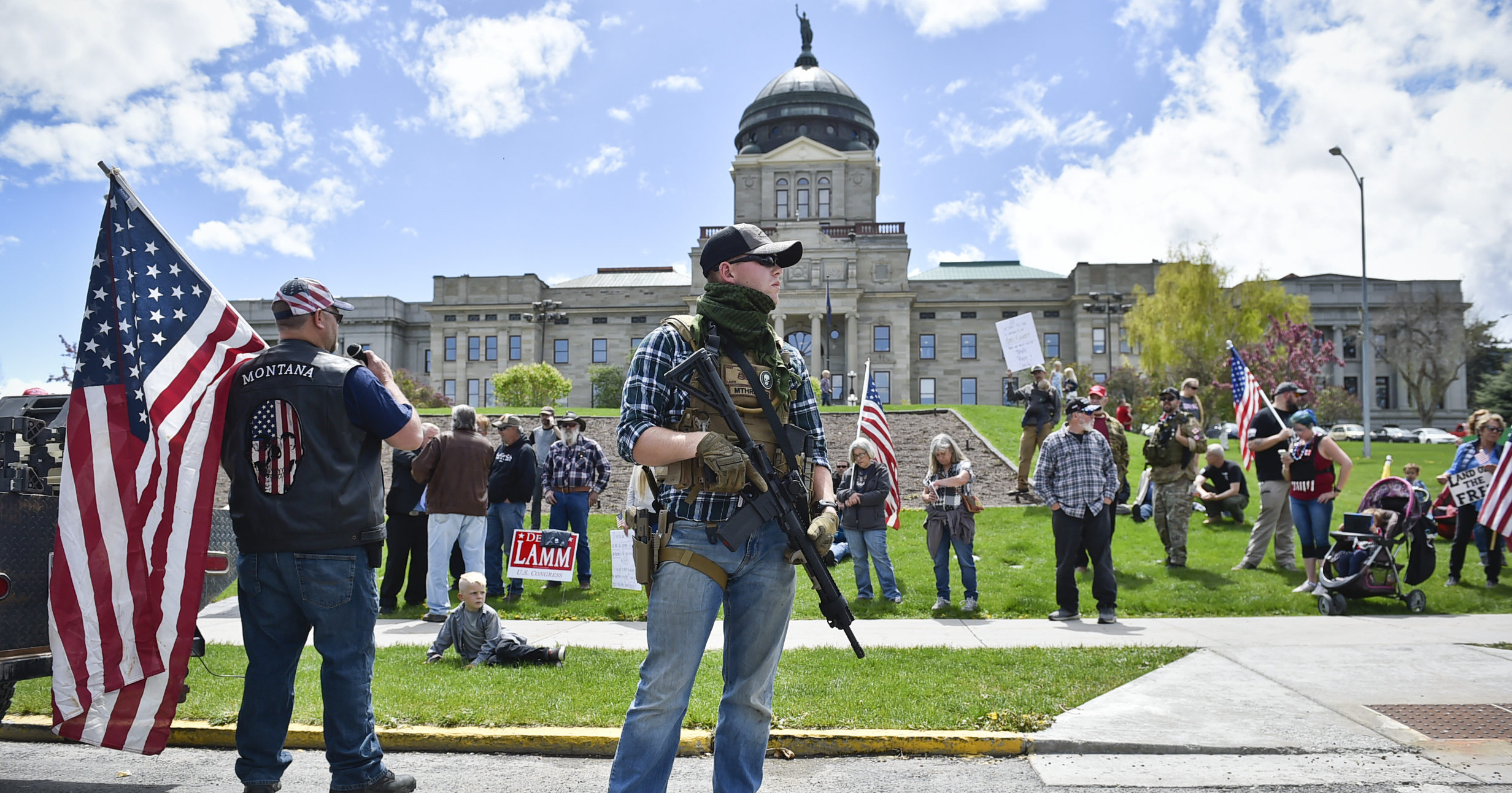 Protesters gather outside the Montana State Capitol in Helena, Montana, on May 20, 2020.