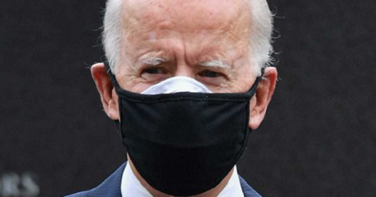 President Joe Biden pictured wearing double masks for coronavirus protection.