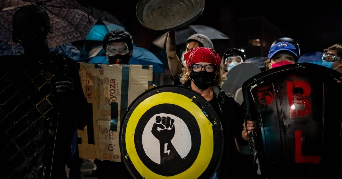 Protesters march on Sept. 7, 2020, following the release of video showing the death of Daniel Prude while in police custody in Rochester, New York. (