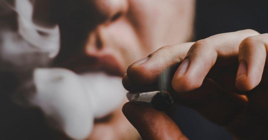 A man smokes marijuana in this stock image.