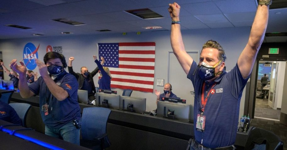 Members of NASA's Perseverance rover team react in mission control after receiving confirmation the spacecraft successfully touched down on Mars on Feb. 18, 2021, at NASA's Jet Propulsion Laboratory in Pasadena, California.