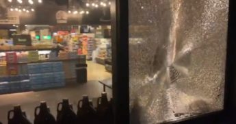 A grocery store window is shattered after violent demonstrations Satuday in Portland, Oregon.