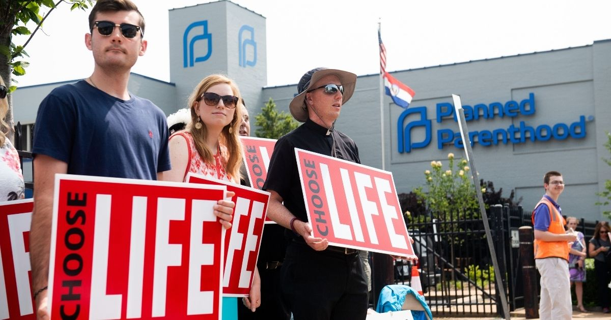 Pro-life demonstrators hold a protest outside the Planned Parenthood Reproductive Health Services Center in St. Louis, Missouri, on May 31, 2019.