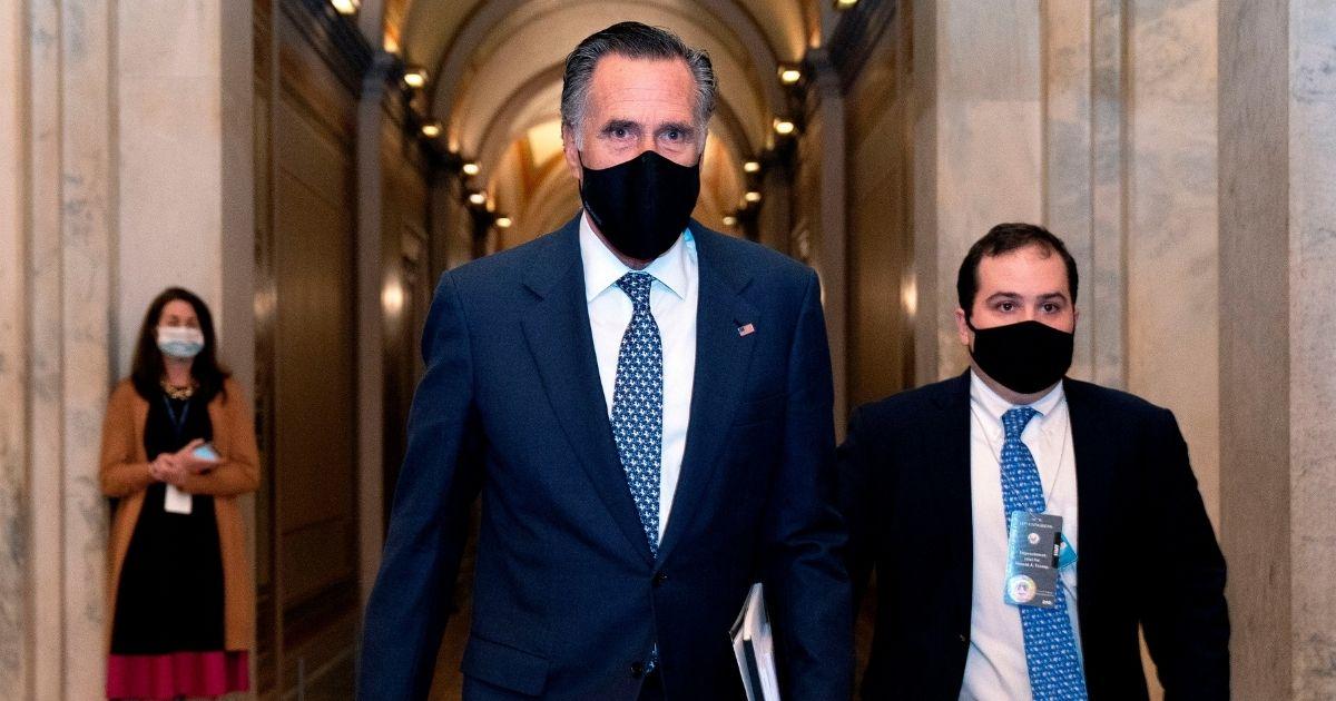 Sen. Mitt Romney leaves the US Capitol on Feb. 13, 2021, in Washington, D.C.