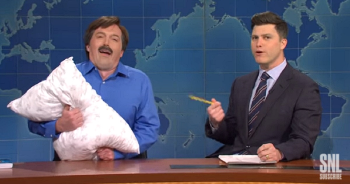 """""""Saturday Night Live's"""" Beck Bennett, left, portrays MyPillow CEO Mike Lindell with """"Weekend Update"""" anchor Colin Jost, right."""