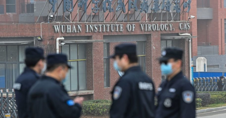 Security personnel stand guard outside the Wuhan Institute of Virology as members of a World Health Organization team investigating the origins of the coronavirus make a visit to the research center in Wuhan, China, on Feb. 3, 2021.