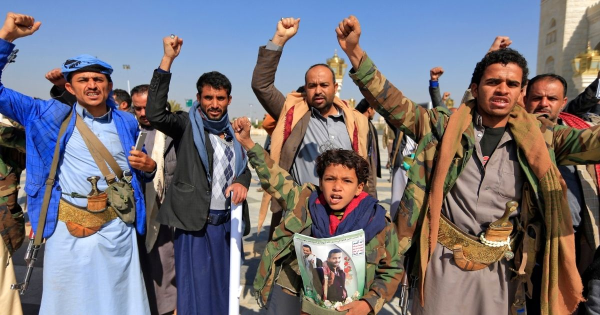 Yemenis gesture during the funeral of pro-Houthi fighters killed in battles in Yemen on Feb. 10, 2021, in the capital Sanaa's al-Saleh mosque.