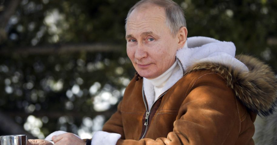 Russian President Vladimir Putin looks on while in a taiga forest in Russia's Siberian region.
