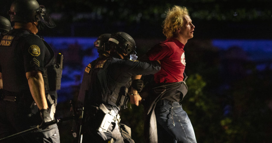Police make arrests at the scene of a protest at a Portland police precinct in Portland, Oregon, on Aug. 30, 2020.