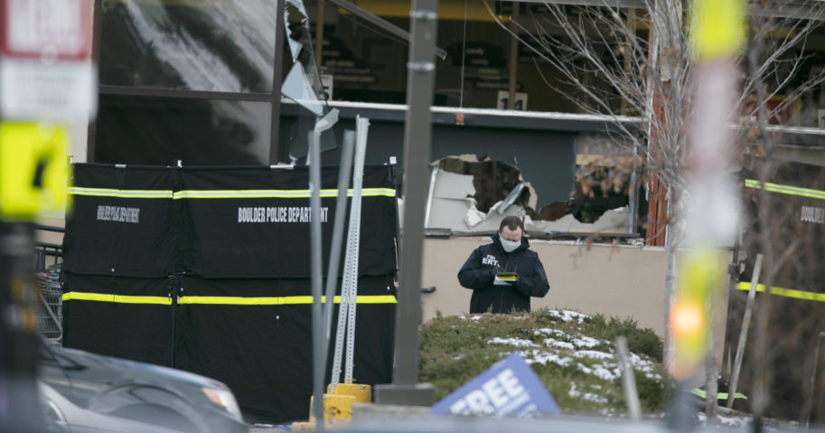 Police work on the scene outside of a King Soopers grocery store in Boulder, Colorado, where authorities say 10 people were killed in a shooting Monday.