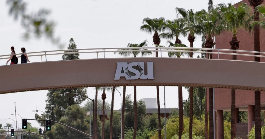 Pedestrians cross over University Ave on the campus of Arizona State University on July 25, 2018, in Tempe, Arizona.