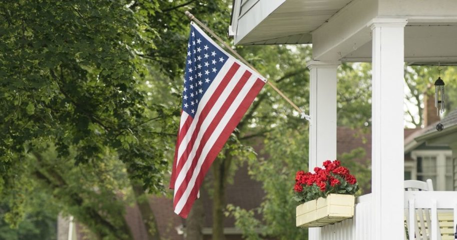 An American flag flies in front of a house.