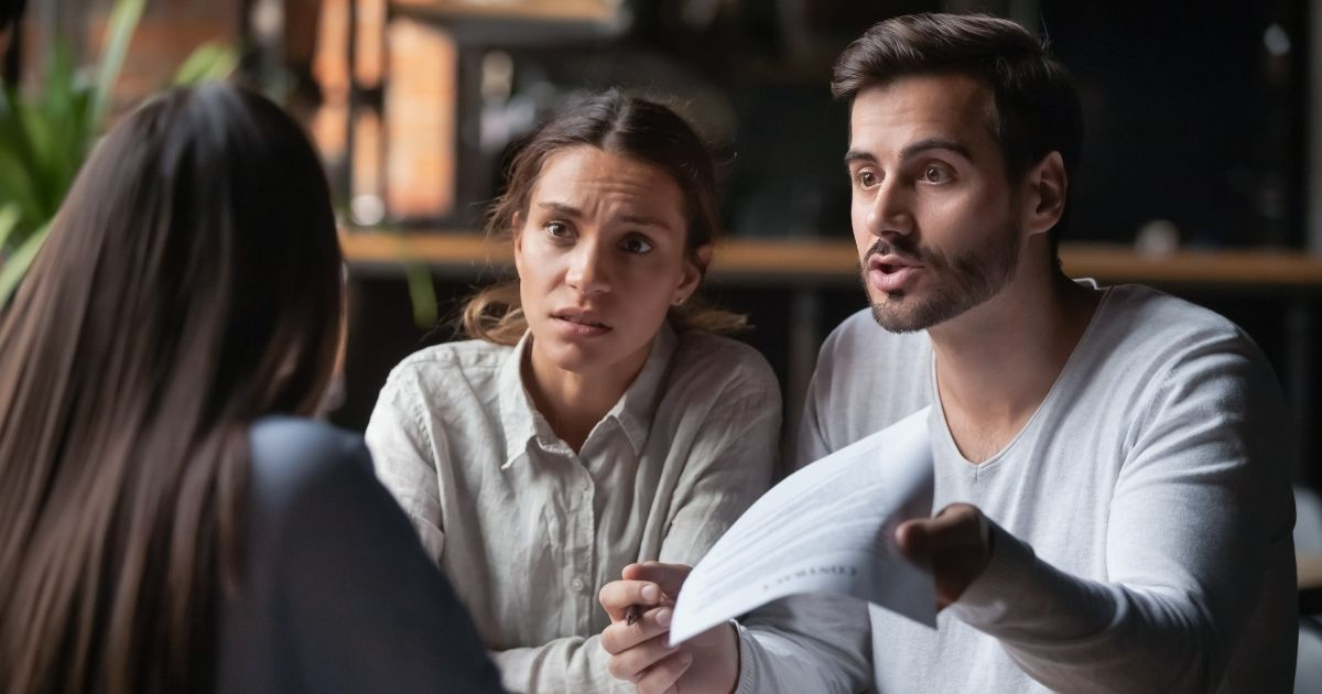 Three people are pictured arguing in the stock image above.