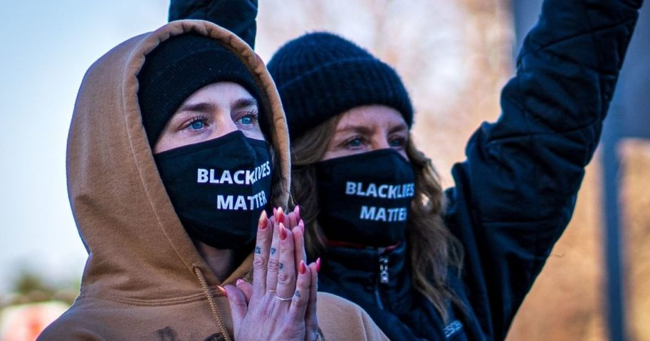 "Two women wearing ""Black Lives Matter"" masks participate in the ""Justice for George Floyd"" march to the Minnesota State Capitol on March 19, 2021, in Saint Paul, Minnesota."