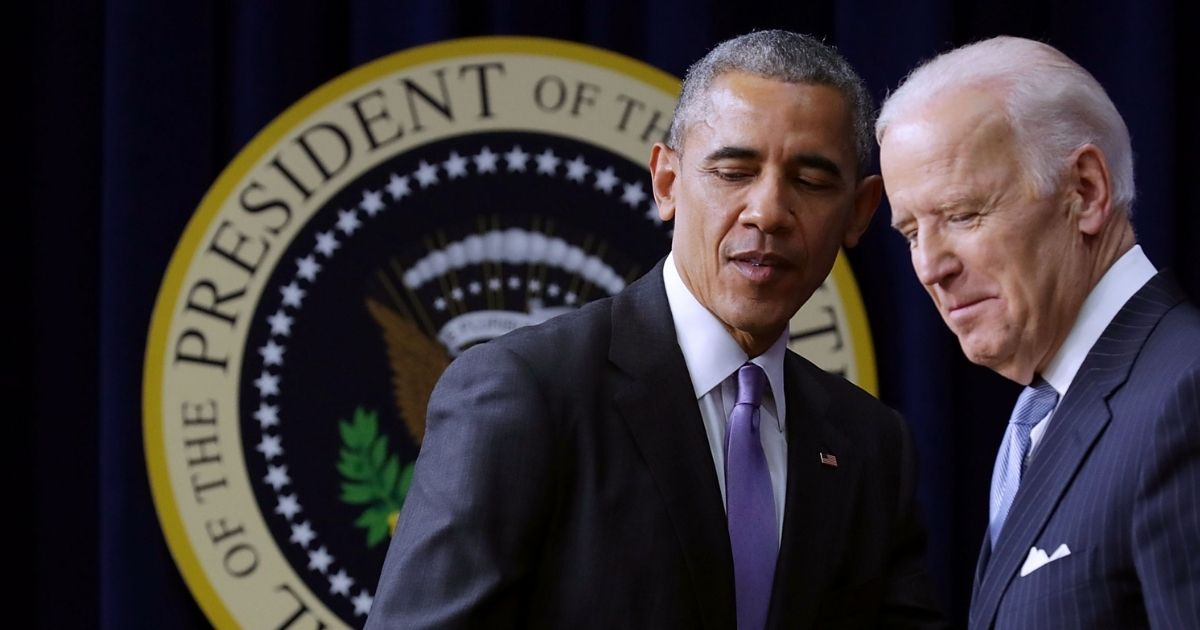 Then-President Barack Obama, left, shakes hands with then-Vice President Joe Biden before signing the 21st Century Cures Act into law at the Eisenhower Executive Office Building on Dec. 13, 2016, in Washington, D.C.