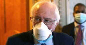 Progressive Vermont Sen. Bernie Sanders passes through a hallway at the U.S. Capitol on March 5 in Washington, D.C.