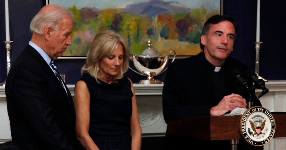 Then-Vice President Joe Biden and his wife, Jill, stand with heads bowed as the Rev. Kevin O'Brien says the blessing during a Thanksgiving dinner in Washington on Nov. 22, 2010.