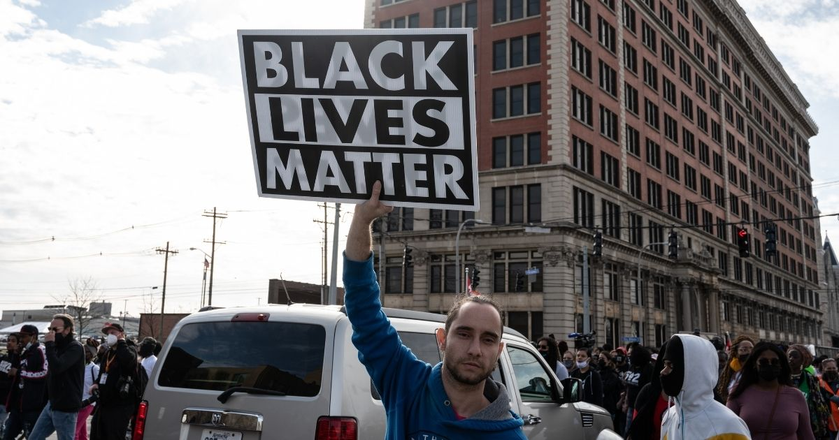A protester displays his Black Lives Matter sign during a Breonna Taylor memorial march near Jefferson Square Park on Saturday in Louisville, Kentucky.