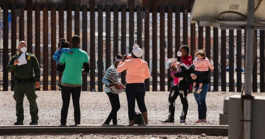 Border Patrol agents apprehend a group of migrants near downtown El Paso, Texas, following the congressional border delegation visit on Monday.