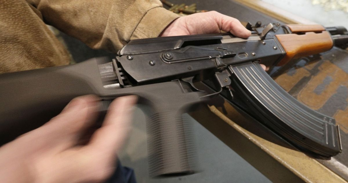 A bump stock is installed on an AK-47 and its movement is demonstrated at Good Guys Gun and Range in Orem, Utah, on Feb. 21, 2018.