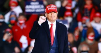 President Donald Trump gestures during a campaign rally on Oct. 17, 2020, in Muskegon, Michigan.