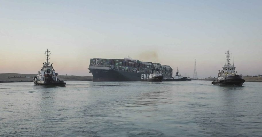 In this photo released by Suez Canal Authority, the Ever Given, a Panama-flagged cargo ship is pulled by tugboats, in the Suez Canal, Egypt, on Monday.