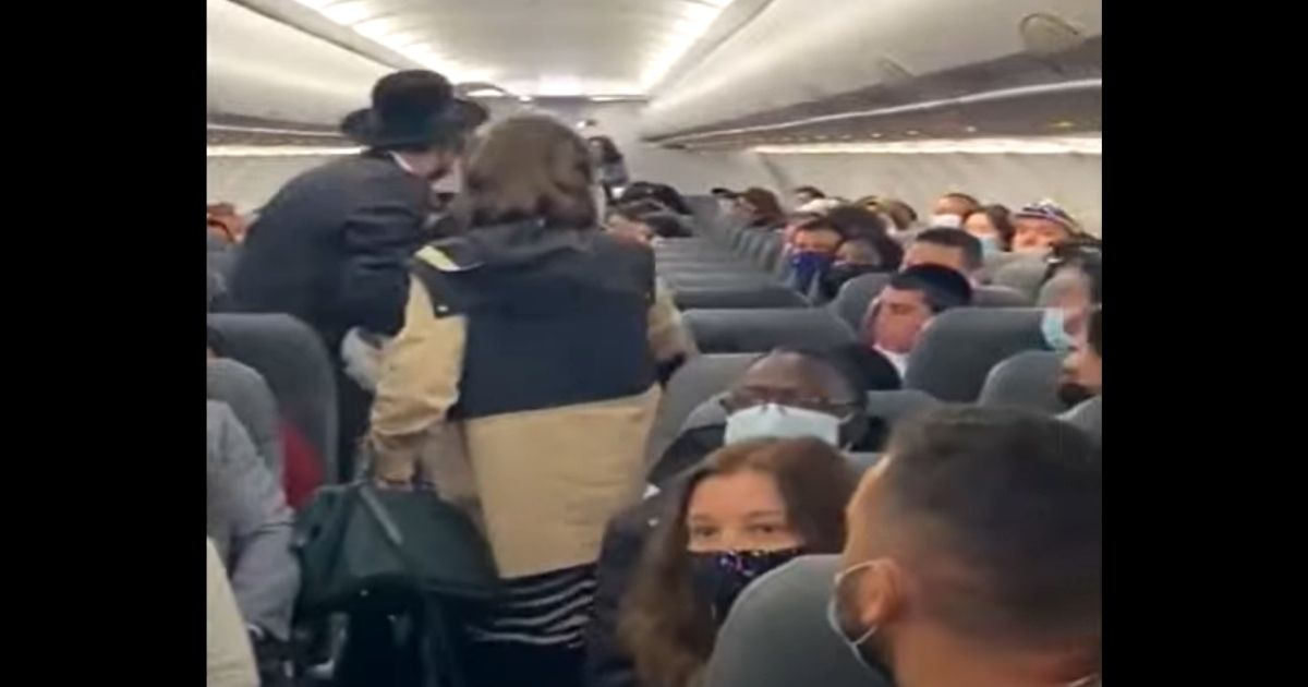 An Orthodox Jewish family is booted off a Frontier Airlines flight.