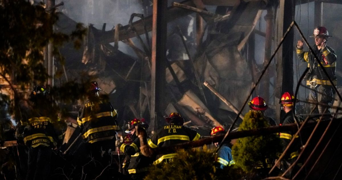 Firefighters work at the scene of a fire that burned down the Evergreen Court Home for Adults on Tuesday in Spring Valley, New York.