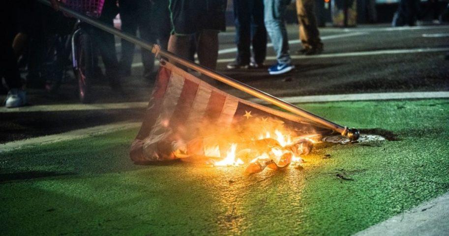 Protesters burn an American flag during a Black Lives Matter demonstration in Portland, Oregon, on Nov. 4.