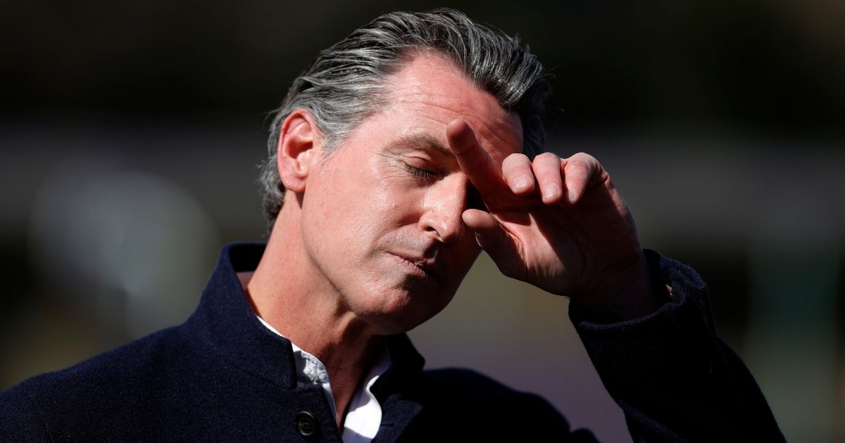 California Gov. Gavin Newsom pauses during a news conference Tuesday in Palo Alto.