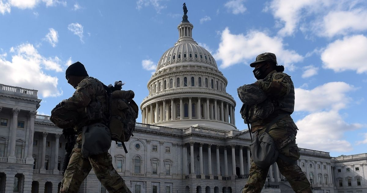 National Guard troops patrol the grounds of the U.S. Capitol in Washington on March 6.