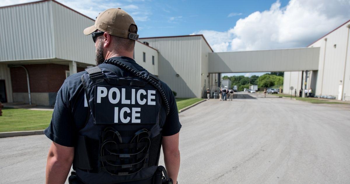 U.S. Immigration and Customs Enforcement's special agent preparing to arrest alleged immigration violators at Fresh Mark, Salem, Ohio, June 19, 2018.
