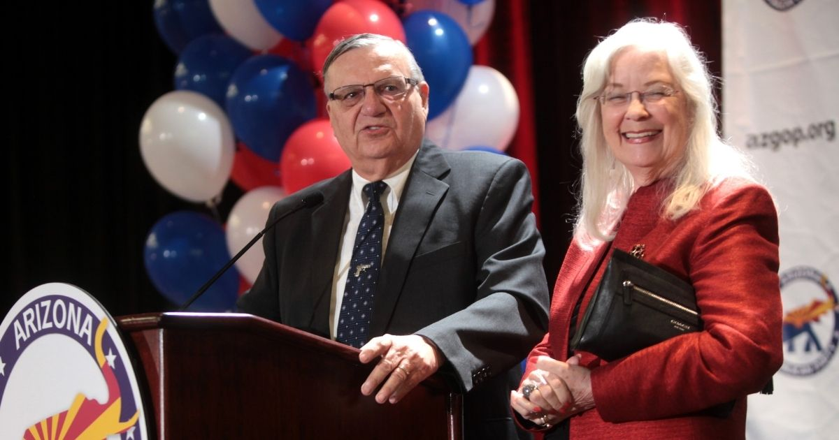 Joe Arpaio, then sheriff of Maricopa County, Arizona, and his wife, Ava, are pictured at Republican Party primary night victory party in Phoenix on Aug. 26, 2014.