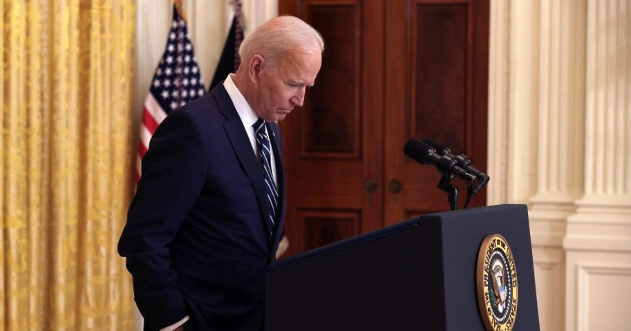 President Joe Biden talks to reporters during the first news conference of his presidency in the East Room of the White House on Thursday in Washington, D.C.