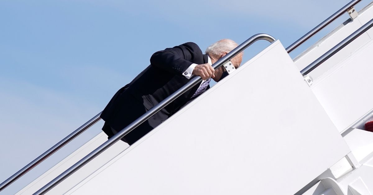President Joe Biden stumbles while boarding Air Force One at Joint Base Andrews in Maryland on Friday.