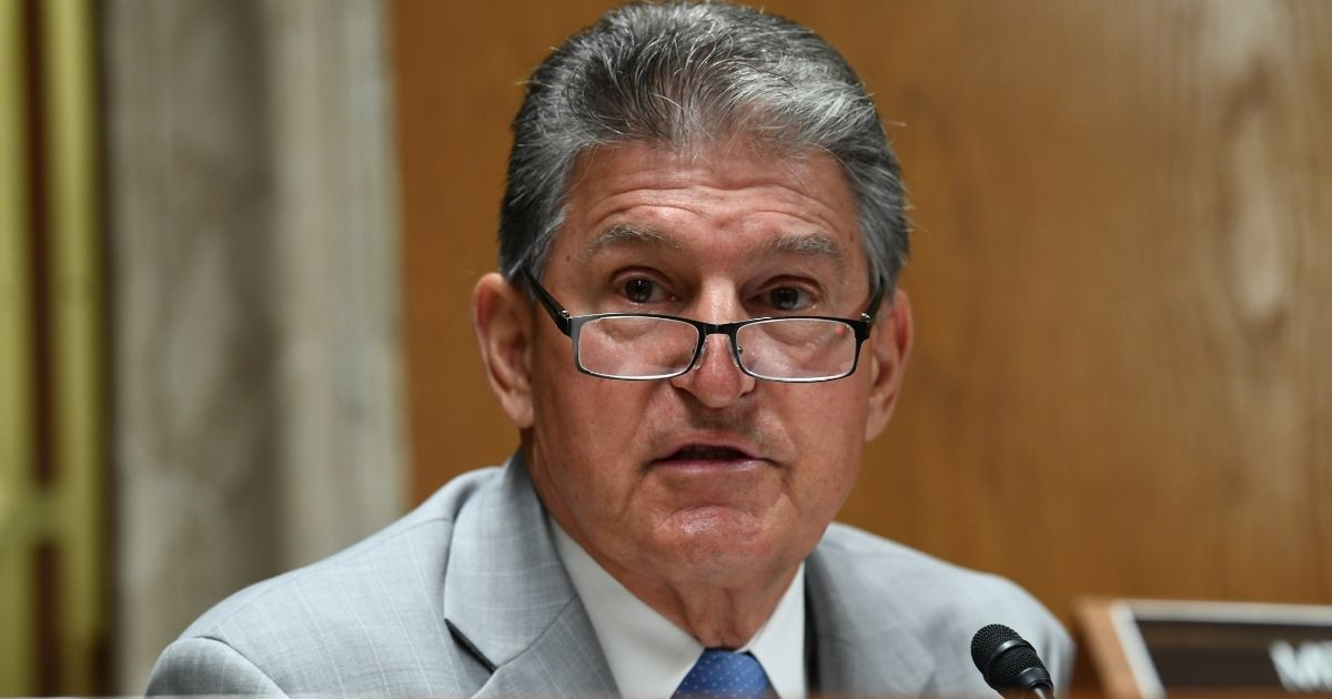 Democratic Sen. Joe Manchin of West Virginia questions Ajit Pai, then the chairman of the Federal Communications Commission, during his testimony before an oversight hearing on June 16, 2020, in Washington, D.C.