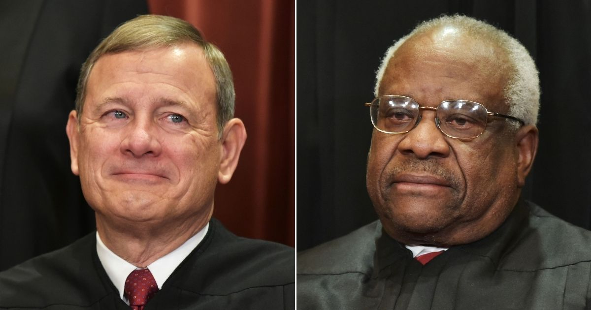 Chief Justice John Roberts, left, and Justice Clarence Thomas of the U.S. Supreme Court pose for official photos at the Supreme Court in Washington, D.C., on Nov. 30, 2018.