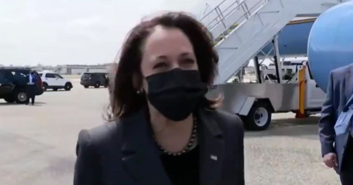 Vice President Kamala Harris laughs as she answers a reporter's question on Monday.
