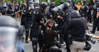 Riot police arrest protesters in Louisville, Kentucky, on Sept. 23, 2020.