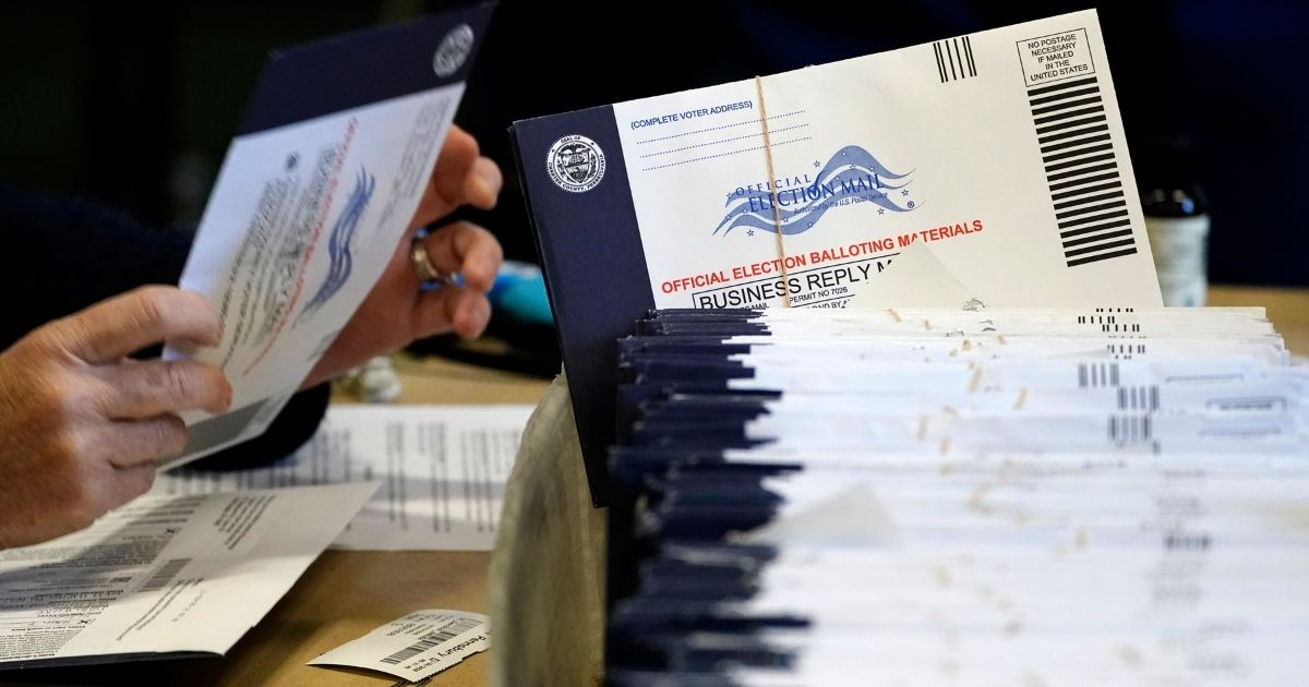 Election workers process mail-in and absentee ballots at West Chester University in West Chester, Pennsylvania, on Nov. 4.