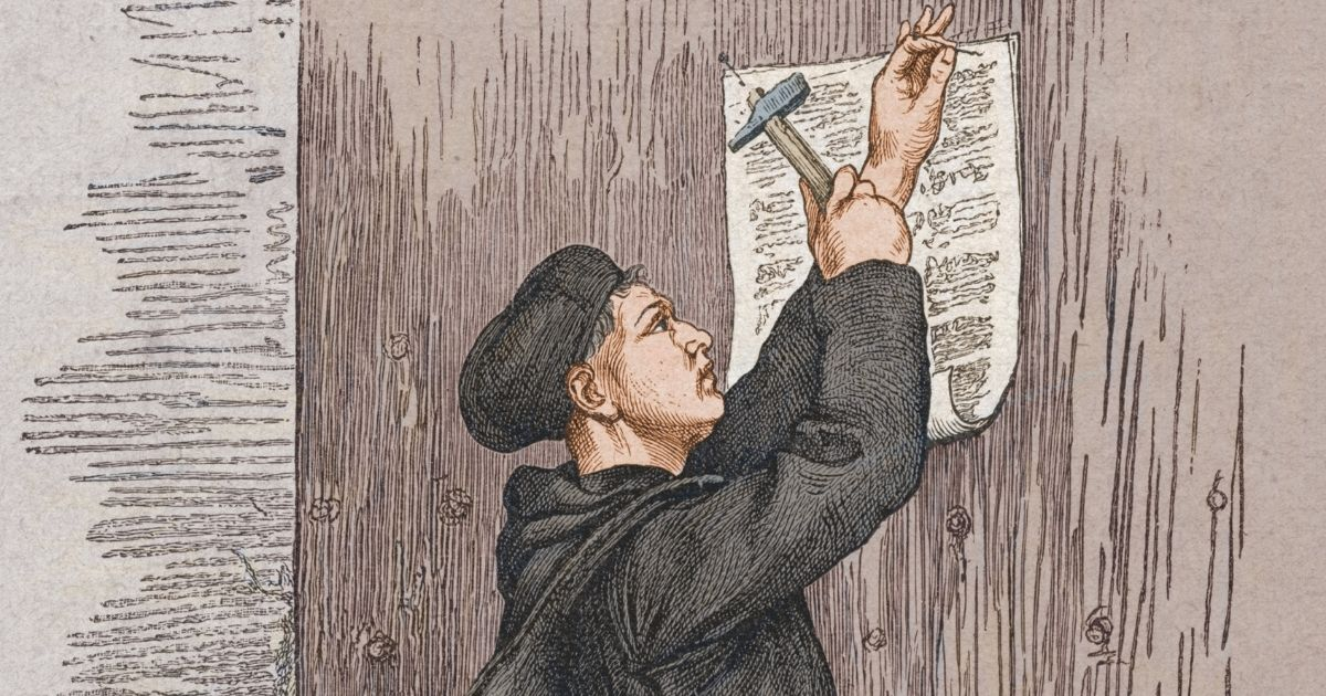 Pictured above is an engraving showing German theologian Martin Luther (1483 - 1546) as he nails the 'Disputation of Martin Luther on the Power and Efficacy of Indulgences' (or the 95 Theses) to the church door in Wittenberg, Germany, on Oct. 31, 1517.