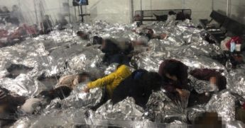 This photo of the CBP facility in Donna, Texas, shows migrants packed together.
