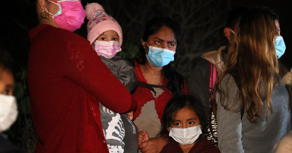 A group of illegal immigrants arrive in Roma, Texas, after they crossed the Rio Grande in a raft guided by Mexican smugglers on Monday.