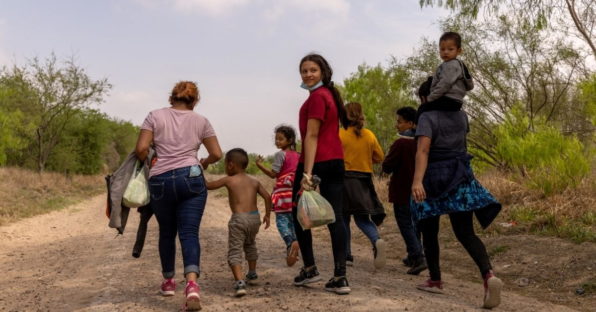 Illegal immigrants from Honduras walk toward a U.S. Border Patrol checkpoint near Mission, Texas, after crossing the Rio Grande from Mexico on March 23