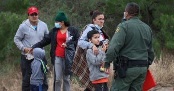 A group of migrants is processed by a U.S. Border Patrol agent after crossing the United States border illegally from Mexico on Monday in La Joya, Texas.