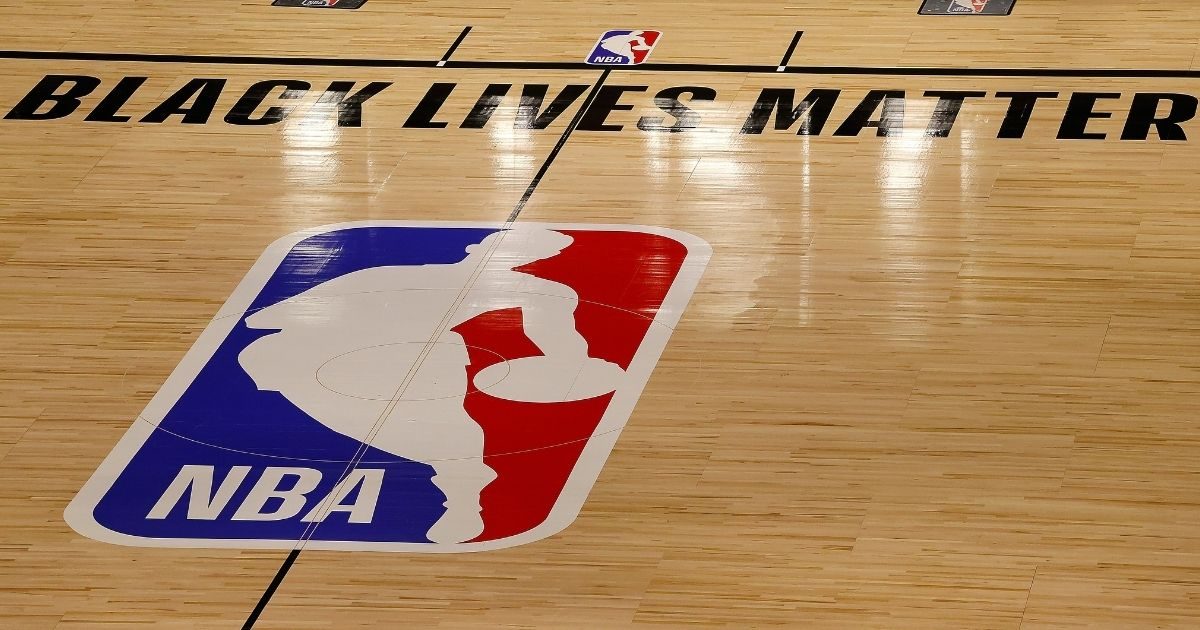 A Black Lives Matter sign is seen on an empty NBA court on Aug. 27, 2020, in Lake Buena Vista, Florida.