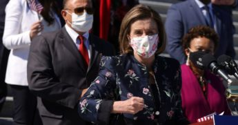 Speaker of the House Rep. Nancy Pelosi speaks as other House Democrats listen during a news conference on the For the People Act at the east front of the U.S. Capitol on March 3, 2021, in Washington, D.C.