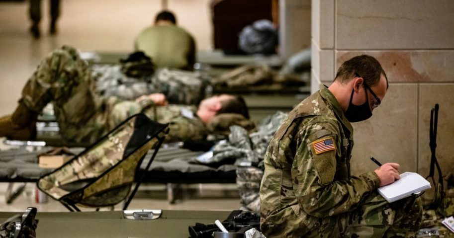 National Guard soldiers rest on cots in the Visitors Center of the U.S. Capitol on Jan. 17, 2021, in Washington, D.C.